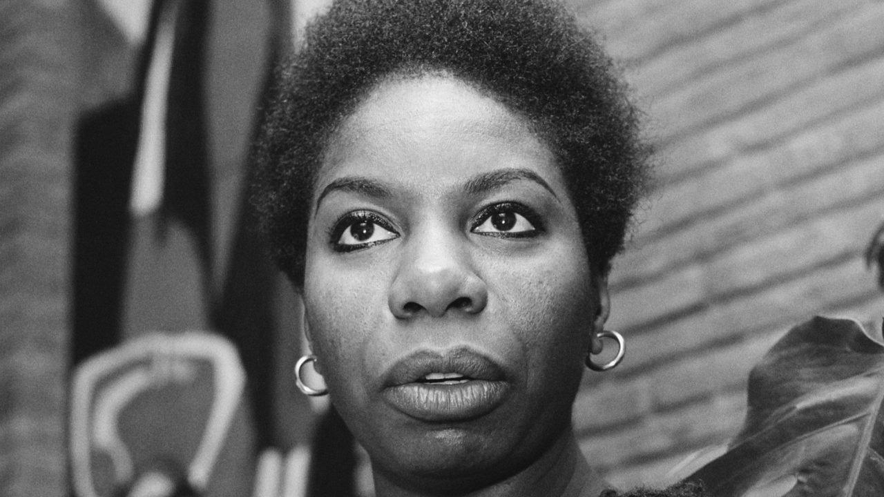 A black and white photo of Nina Simone